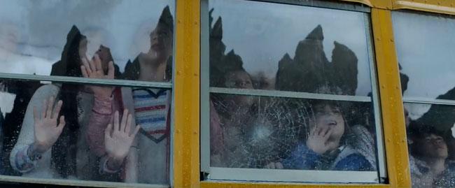 Godzilla international trailer shows new scenes of destruction (children on school bus)