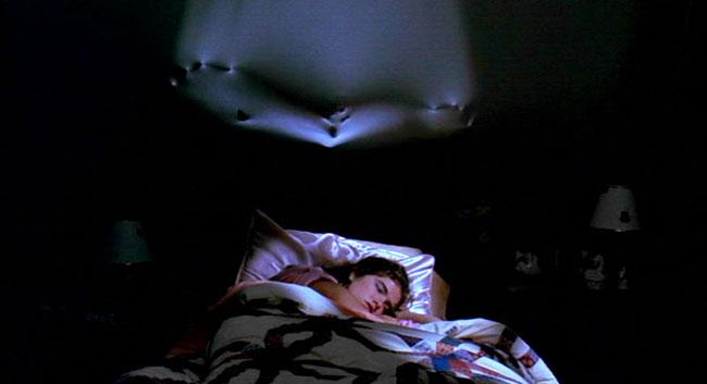 Nightmare on Elm Street Nancy sleeping bed Freddy wall.